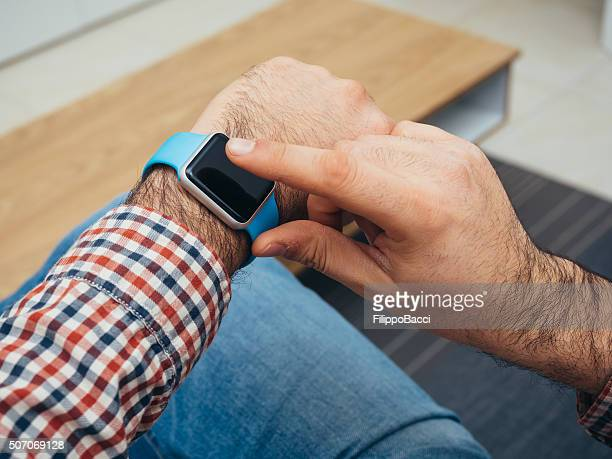 Adult Man Using His Technological Watch