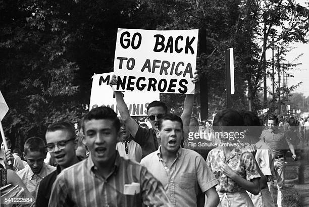 Adult members of the Ku Klux Klan and White Citizens' Councils join teengers protesting school desegregation in Montgomery The Supreme Court ordered...
