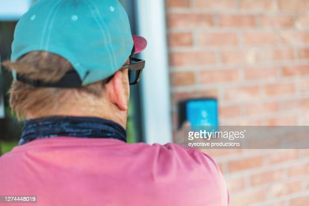 adult millennial male college student in wheelchair entering admission building - college admission stock pictures, royalty-free photos & images