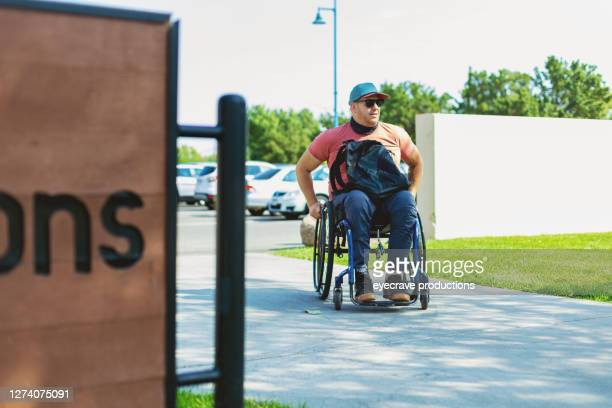 adult millennial male college student in wheelchair photo series - college admission stock pictures, royalty-free photos & images