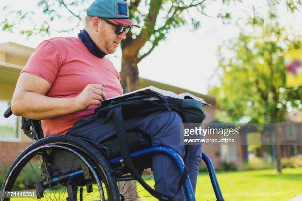 adult millennial male college student in wheelchair - college admission stock pictures, royalty-free photos & images