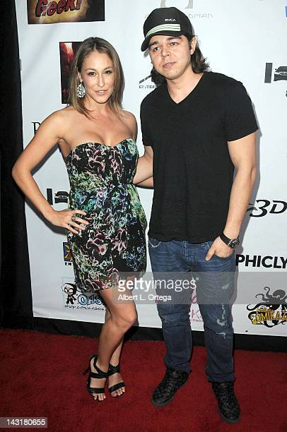Adult model Ryan Keely and guest arrive for the Premiere Of With Great Power The Stan Lee Story held at iPic Theaters on April 19 2012 in Pasadena...