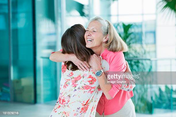 Adult mother and daughter embracing