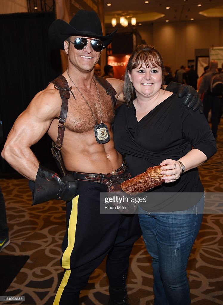 Adult performance artist Brent Ray Fraser (L) takes a photo with Crystal Gibb of Missouri at the 2015 AVN Adult Entertainment Expo at the Hard Rock Hotel & Casino on January 22, 2015 in Las Vegas, Nevada.