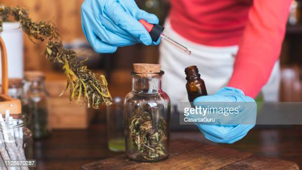 Adult Preparing Homeopathic Medicine From Cannabis Buds