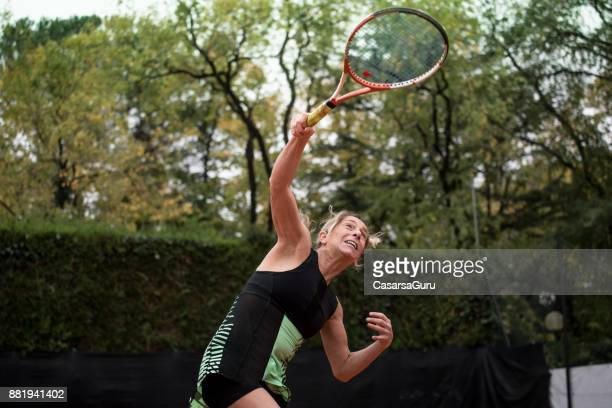 Adult Recreational Tennis Player Serving