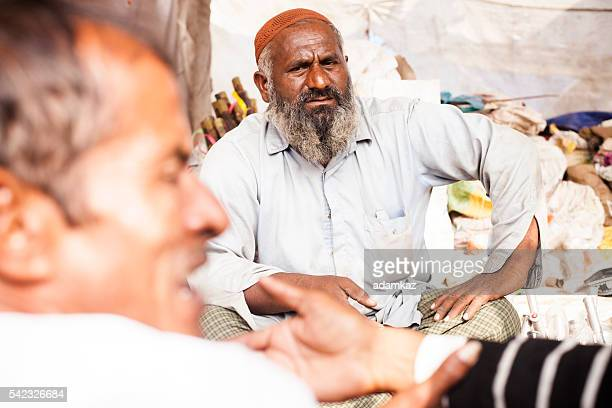 Adult Senior Indian Vendor Selling Axe Head