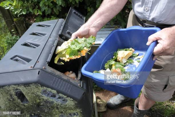 adult senior man composting food waste - rafael ben ari fotografías e imágenes de stock