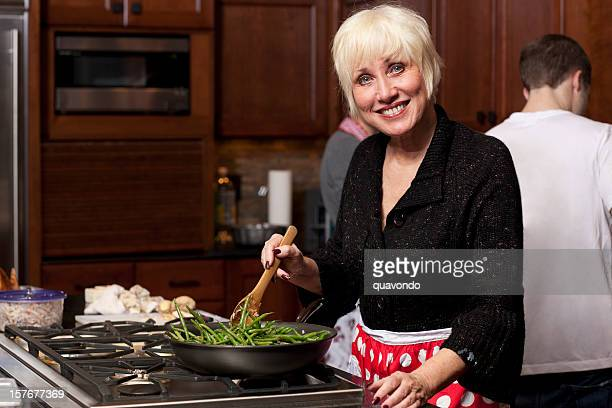 Adult Senior Mom Cooking Thanksgiving Dinner with Family, Copy Space