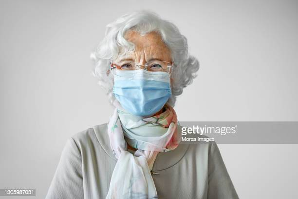 adult senior woman in face mask during covid-19 - white hair stock pictures, royalty-free photos & images