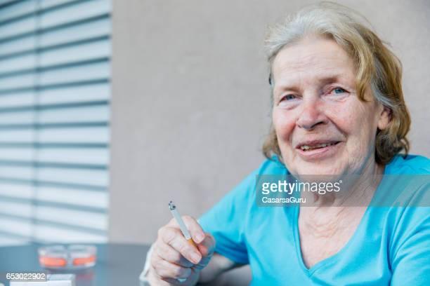 Adult Senior Woman In The Care Center Taking Break