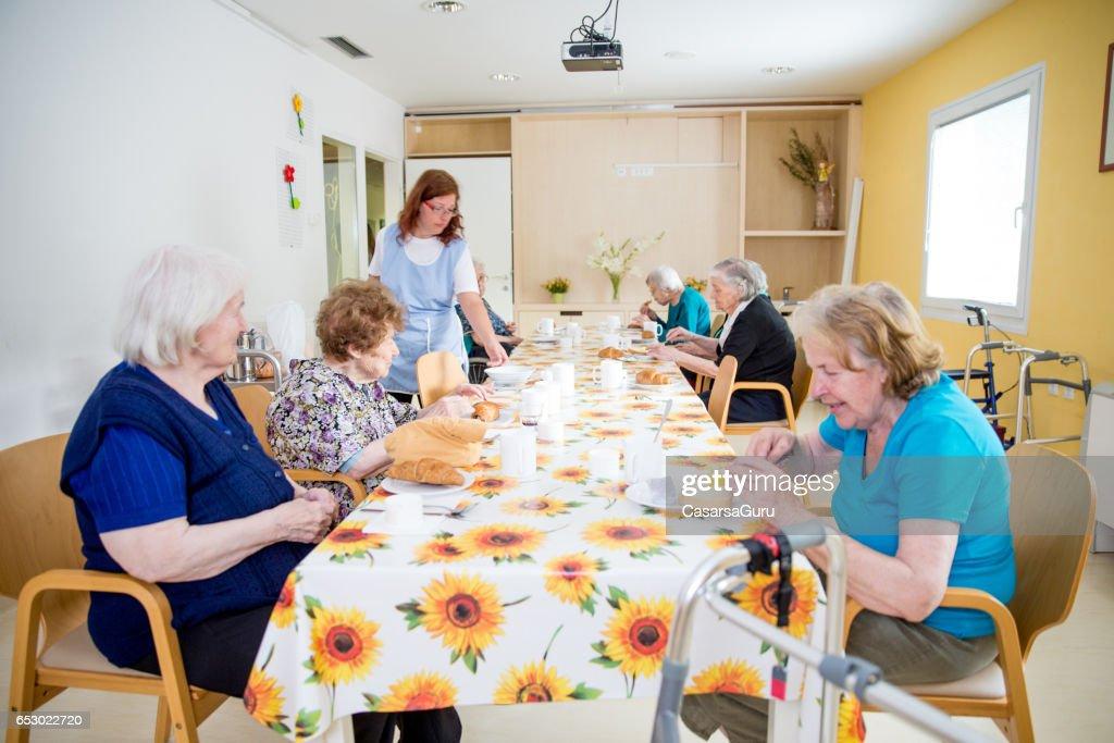 Adult Seniors Having Breakfast At The Care Center : Stock Photo