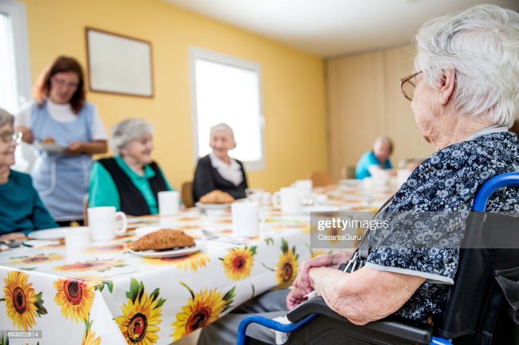 Adult Seniors Having Breakfast At The Care Center : Foto stock