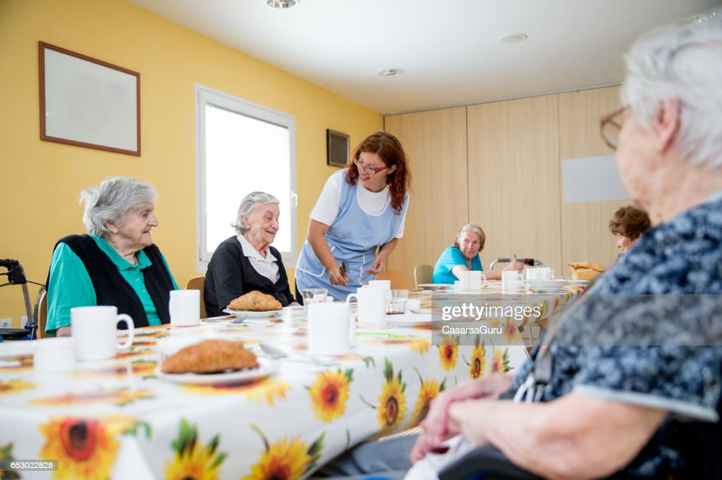 Adult Seniors Having Breakfast At The Care Center : Foto stock