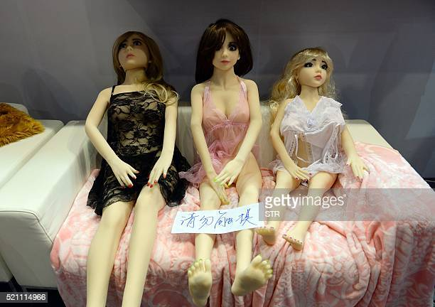 Adult sex dolls are on display with a notice which translates as 'Please do not touch' during the 2016 Shanghai International Adult Toys and...