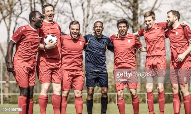 adult soccer team celebrating winning a football tournament - team sport stock pictures, royalty-free photos & images
