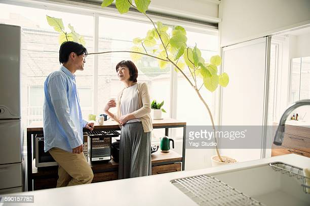 adult son and mother having a good time - japan mom and son stock photos and pictures