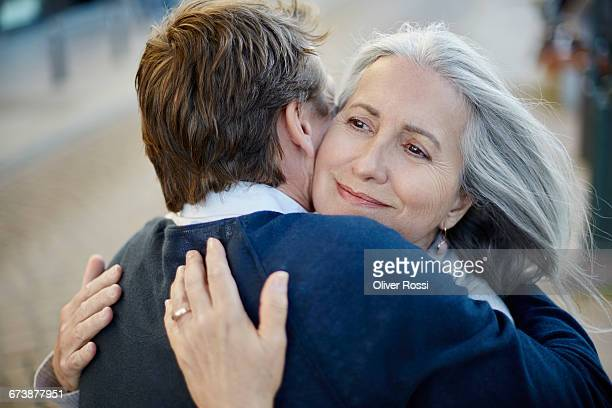 Adult son hugging mature mother