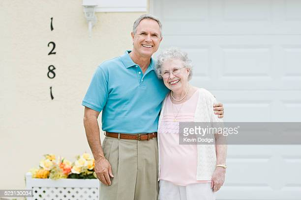 Adult Son with Arm Around Elderly Mother
