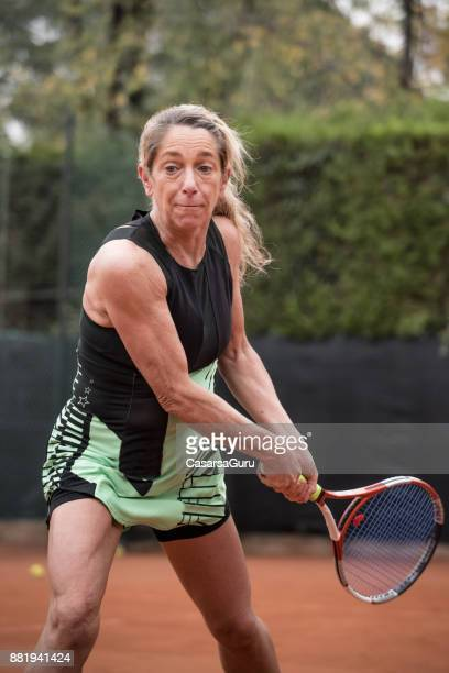 Adult Sportsperson Swinging a Tennis Racket