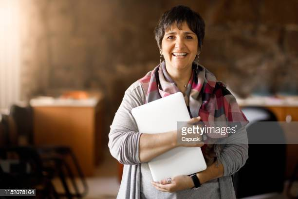 adult student holding laptop - instructor stock pictures, royalty-free photos & images