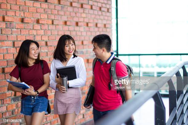 adult student walking together in the campus - students' union stock pictures, royalty-free photos & images