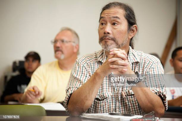 adult students listening in classroom - community_college stock pictures, royalty-free photos & images