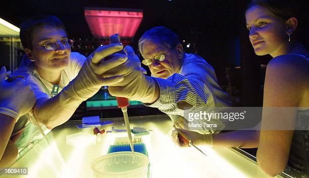 Adult students participate in a genomic laboratory workshop August 15 2001 at the American Museum of Natural History in New York City The workshop...