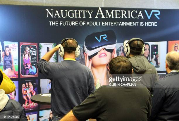 Adult video company Naughty America provides a gander at virtual reality content during the Consumer Electronics Show on January 8 2017 in Las Vegas...