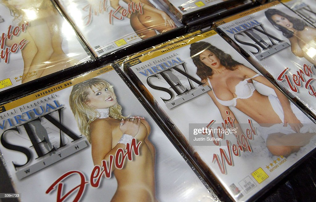 Adult videos are shown on display at the AVN Adult Entertainment Expo January 10, 2004 in Las Vegas. Adult movie industry producers in Los Angeles have shut down sets and stopped many actors April 16, 2004 from working after two actors tested positive for the virus that causes AIDS in Los Angeles.