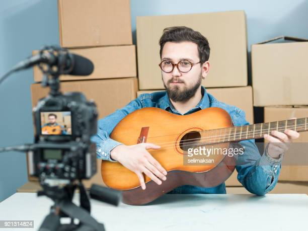 Adult Vlogger Man Recording Video Of Guitar Lessons For Video Blogging