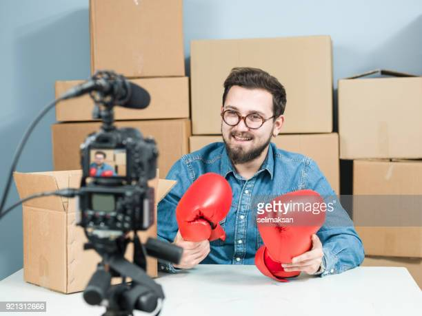 Adult Vlogger Man Recording Video Of Unboxing Boxing Gloves For Video Blogging