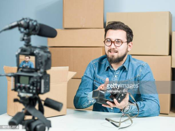 Adult Vlogger Man Recording Video Of Unboxing Camera For Video Blogging