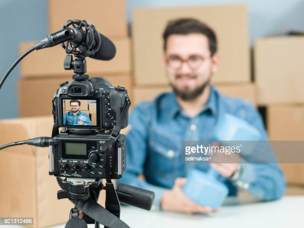 Adult Vlogger Man Recording Video Of Unboxing Sport Items For Video Blogging