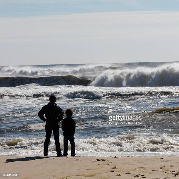 adult with child on beach, sag harbor, new york, usa - sag harbor stock photos and pictures