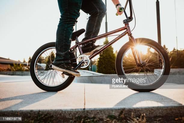 adult woman bmx bike rider at ramp park - bmx cycling stock pictures, royalty-free photos & images