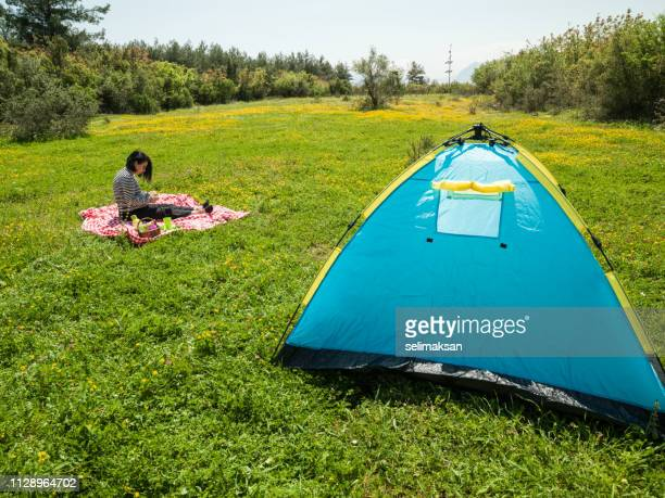 Adult Woman Camping In Nature During Springtime