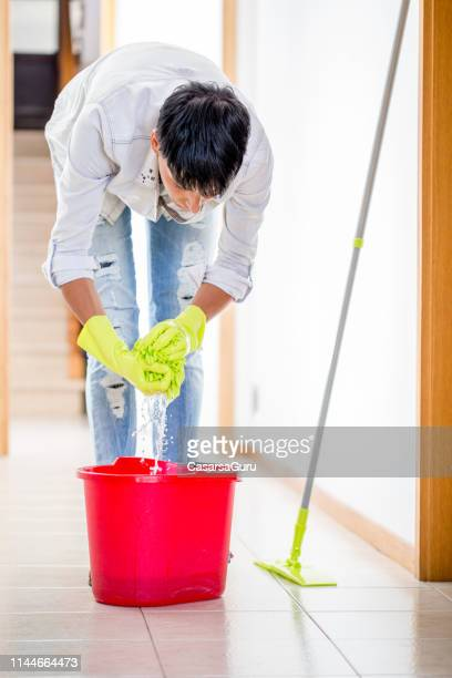 adult woman cleaning floor with a mop - daily bucket stock pictures, royalty-free photos & images