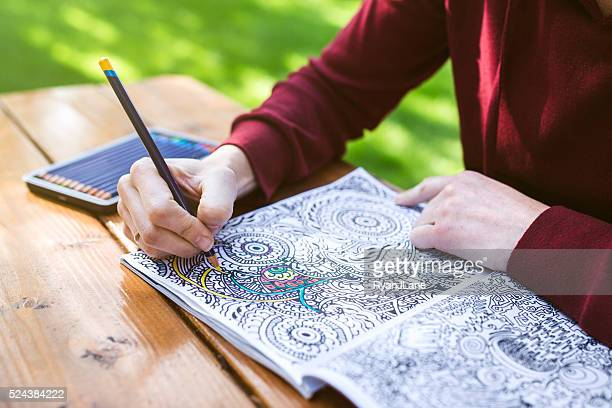 adult woman coloring - colouring stock pictures, royalty-free photos & images