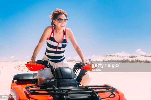 Adult woman driving off road ATV