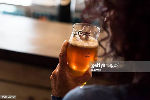 Adult Woman Enjoying Drinking A Glass of Craft Beer