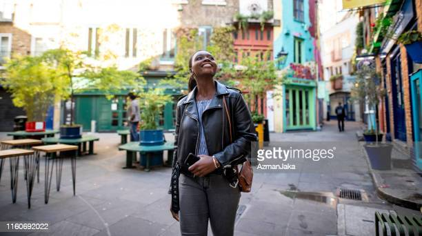 adult woman exploring neal's yard in london - walking stock pictures, royalty-free photos & images