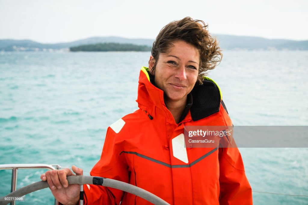 Adult Woman Holding the Rudder : Stock Photo