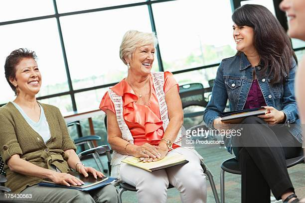 Adult woman laughing together in a meeting