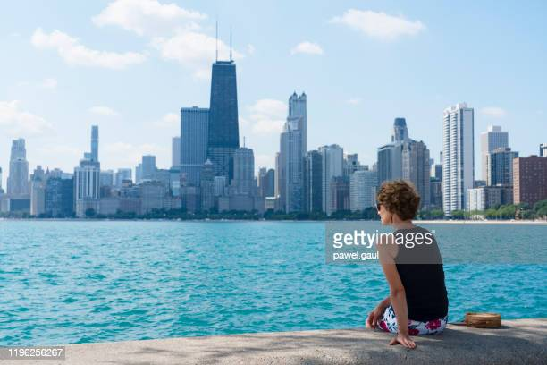 adult woman looking at chicago skyline - lake michigan stock pictures, royalty-free photos & images