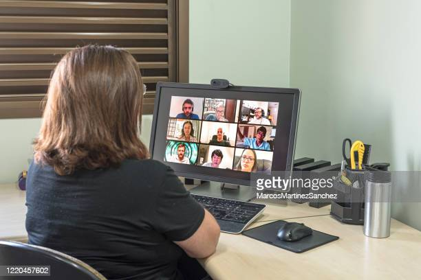 adult woman making conference call with friends - hd stock pictures, royalty-free photos & images
