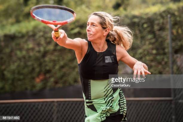 Adult Woman Playing Tennis