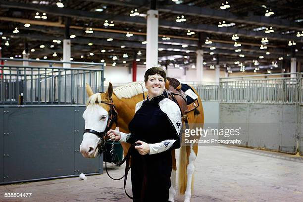 Adult woman rider getting ready to compete in the Houston Livestock Show and Rodeo