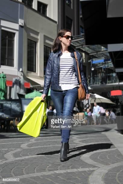 adult woman shopping in city downtow - rafael ben ari stock-fotos und bilder