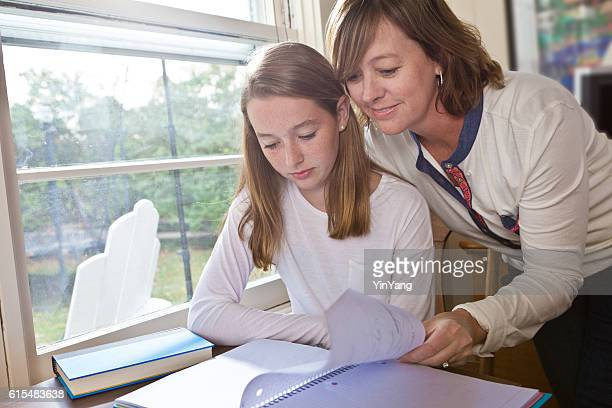 Adult Woman Teacher or Mother Helping Girl Studying and Homework